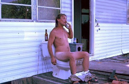 Naked man on ouside toilet on phone